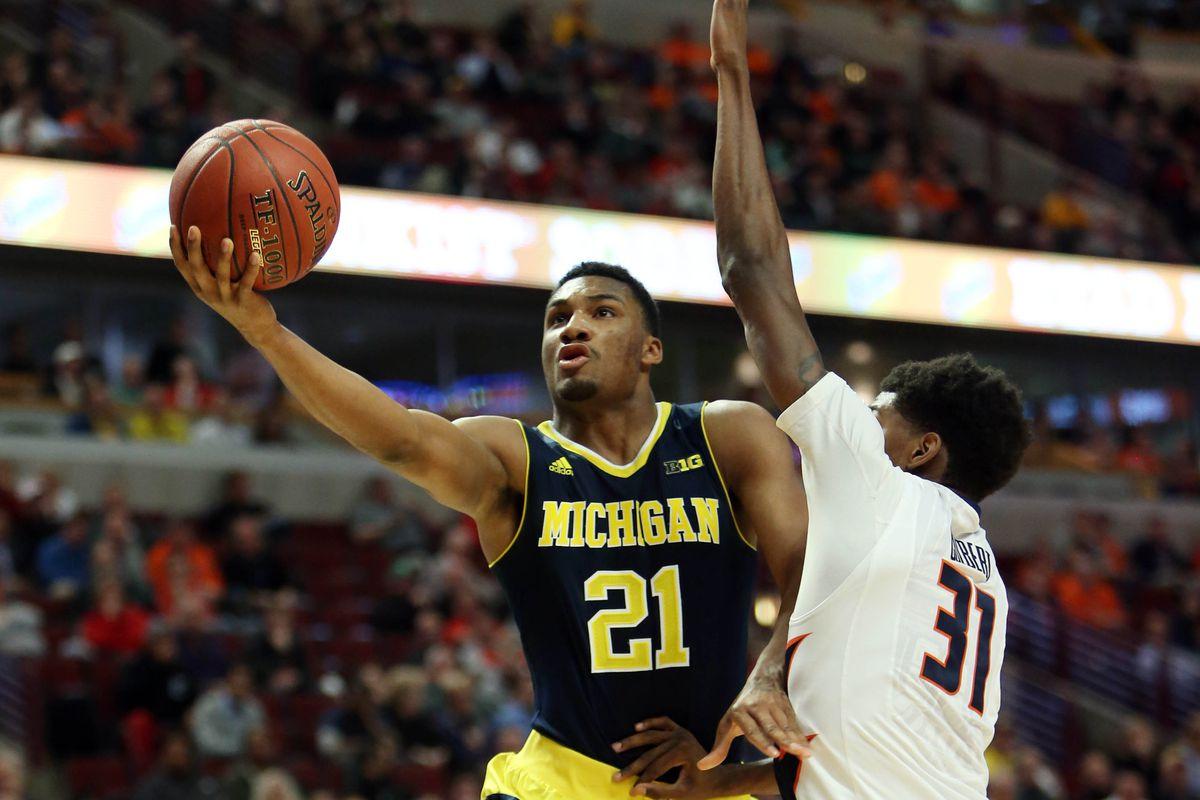 Zak Irvin of Michigan goes by Austin Colbert of Illinois