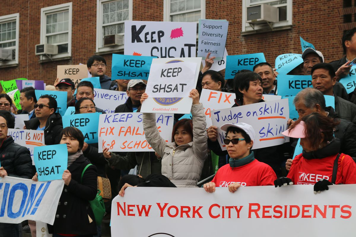 Advocates rallied ahead of a public forum at Queens Borough Hall to discuss segregation at the city's elite specialized high schools.