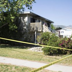 Family and friends of a woman killed in an early morning fire gather in the backyard of the West Valley home on Monday, June 5, 2017.