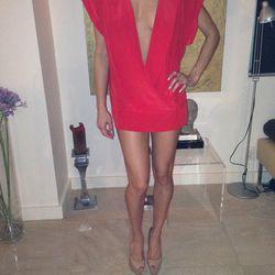 "BCBG plunging mini dress, <a href=""http://www.ebay.com/itm/Lilly-Ghalichi-BRIGHT-SEXY-Super-Low-V-MINI-dress-or-Top-/181056435064?pt=US_CSA_WC_Dresses&hash=item2a27cdf378"">$155</a>."