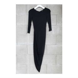 """<a href=""""http://www.mikkatmarket.com/product/cut-out-back-asymmetric-dress"""">Cut-out back asymmetric dress</a>, $45 <br></br> <b>Mikkat Market:</b> There are no sparkly or otherwise in-your-face festive dresses here. But for simple, affordable looks, thi"""