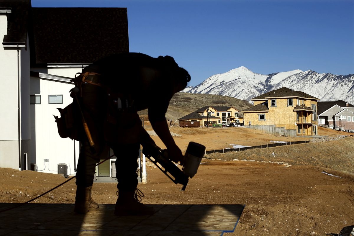 Joel Rodriguez of C & S Contractors builds a house in a new development called Seasons Estates in Lehi on Thursday, Feb. 20, 2020.