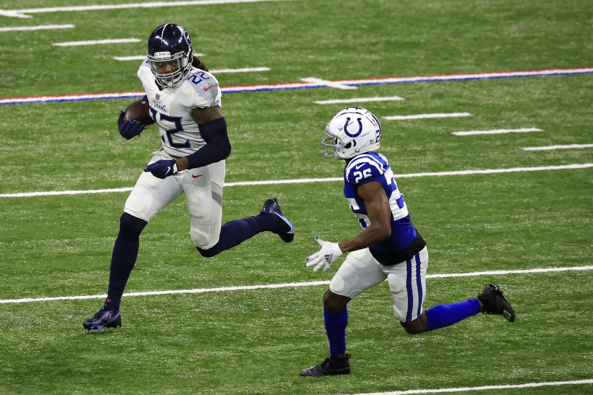 Derrick Henry #22 of the Tennessee Titans looks to gain yardage in the third quarter against Rock Ya-Sin #26 of the Indianapolis Colts during their game at Lucas Oil Stadium on November 29, 2020 in Indianapolis, Indiana.