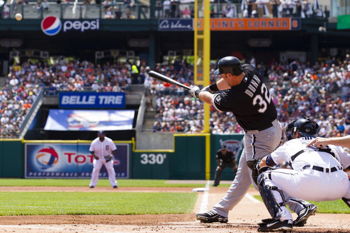 May 5, 2012; Detroit, MI, USA; Chicago White Sox first baseman Adam Dunn (32) hits a home run during the first inning against the Detroit Tigers at Comerica Park. Mandatory Credit: Rick Osentoski-US PRESSWIRE