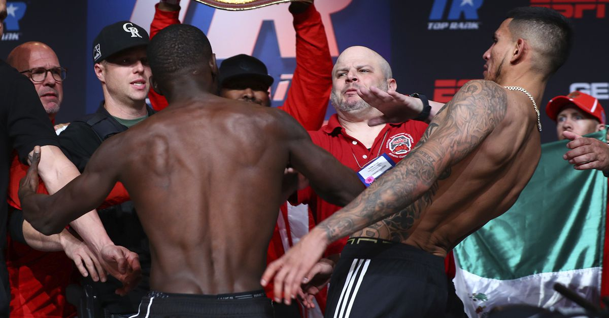 Video: Terence Crawford throws punch at Jose Benavidez Jr during weigh-ins stare...