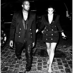 Stepping out in identical gold-buttoned Balmain blazers in November 2014.