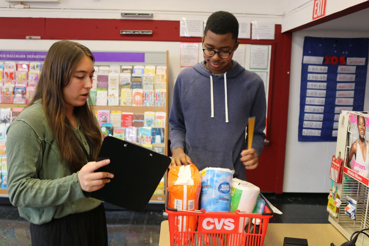 Sebi Smith shops for items at a mock CVS while his teacher, Miranda Haraughty, makes sure he got everything on his list.