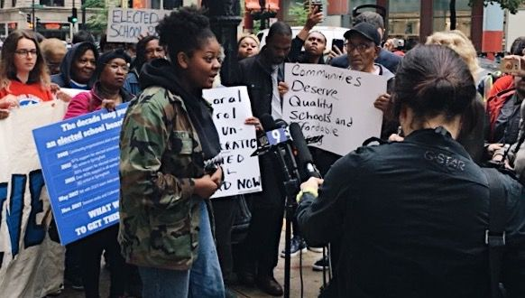Alycia Moaton speaking at a protest last year outside City Hall.