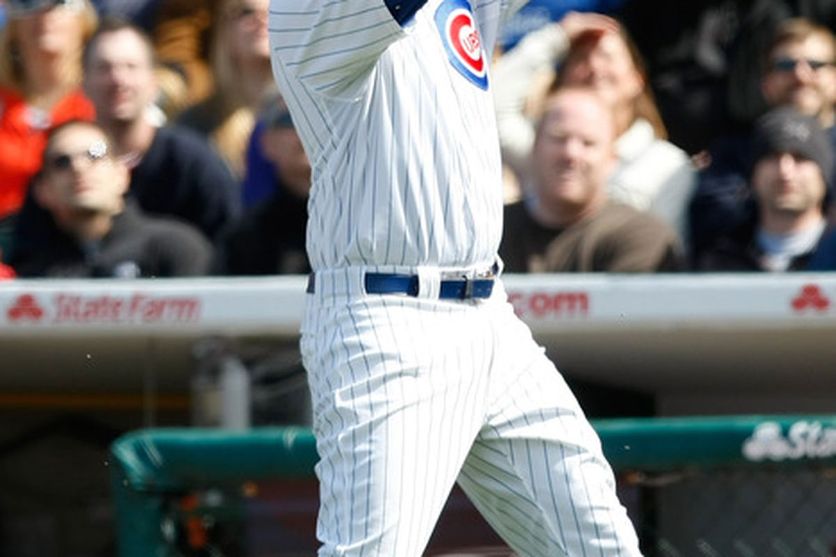 Bryan LaHair of the Chicago Cubs catches the baseball to end the game against the Cincinnati Reds at Wrigley Field in Chicago, Illinois. The Cubs defeated the Reds 6-1. (Photo by Scott Boehm/Getty Images)