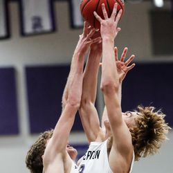 Riverton's Cody Nixon (3) grabs a rebound with his teammate in a high school boys basketball game at Riverton High School in Riverton on Friday, Dec. 18, 2020.