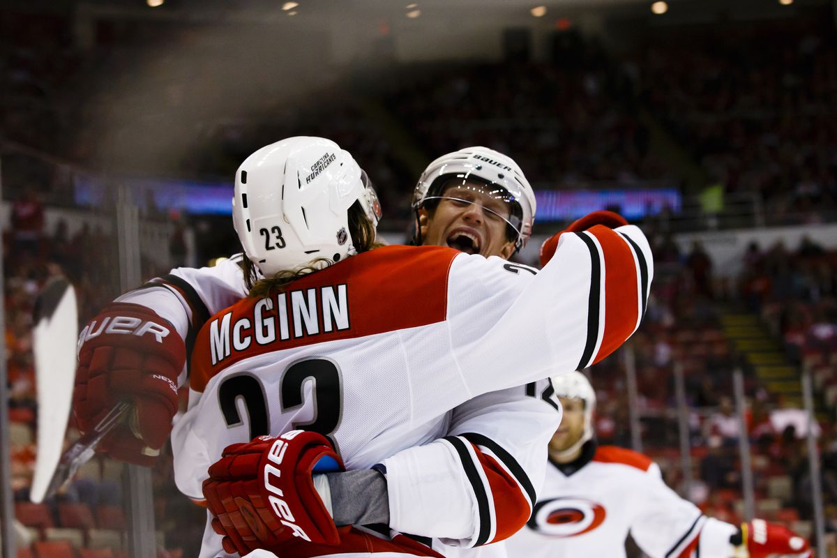 Brock McGinn celebrates with Eric Staal after scoring his first career NHL goal.