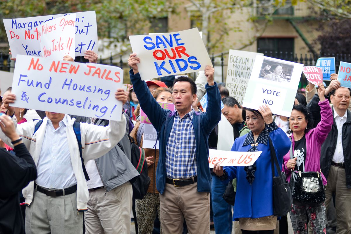 Hundreds of Chinatown residents protest Mayor Bill de Blasio's plan to close Rikers Island, Oct. 6, 2019.