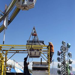 Martin Vasquez and Manuel Hernandez build the ferris wheel at the Utah State Fairpark in Salt Lake City on Wednesday, Sept. 4, 2013. The fair runs Sept. 5-15.