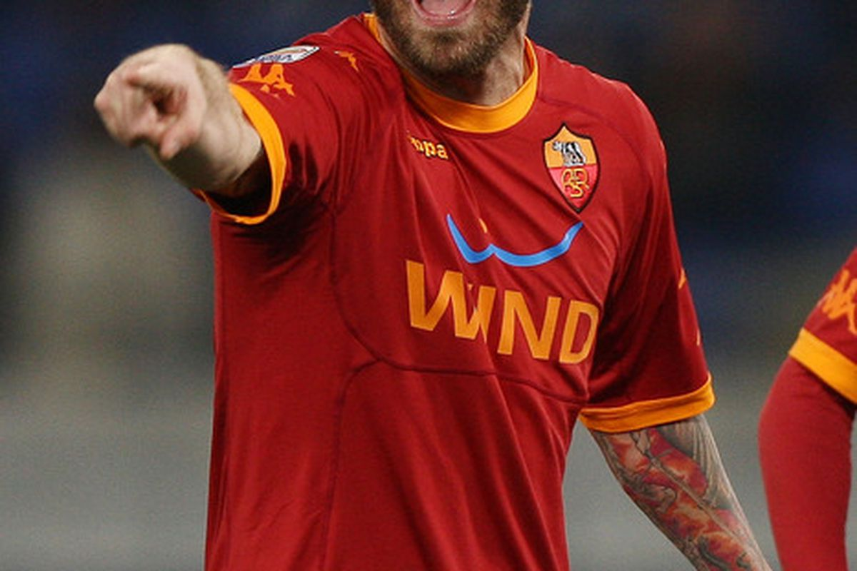 ROME ITALY - FEBRUARY 02:  Daniele De Rossi of AS Roma reacts during the Serie A match between AS Roma and Brescia Calcio at Stadio Olimpico on February 2 2011 in Rome Italy.  (Photo by Paolo Bruno/Getty Images)