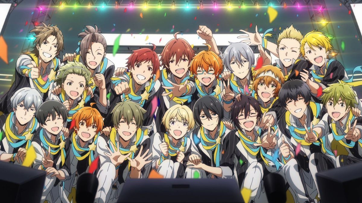 A bunch of male anime characters in matching outfits pose at the edge of a stage