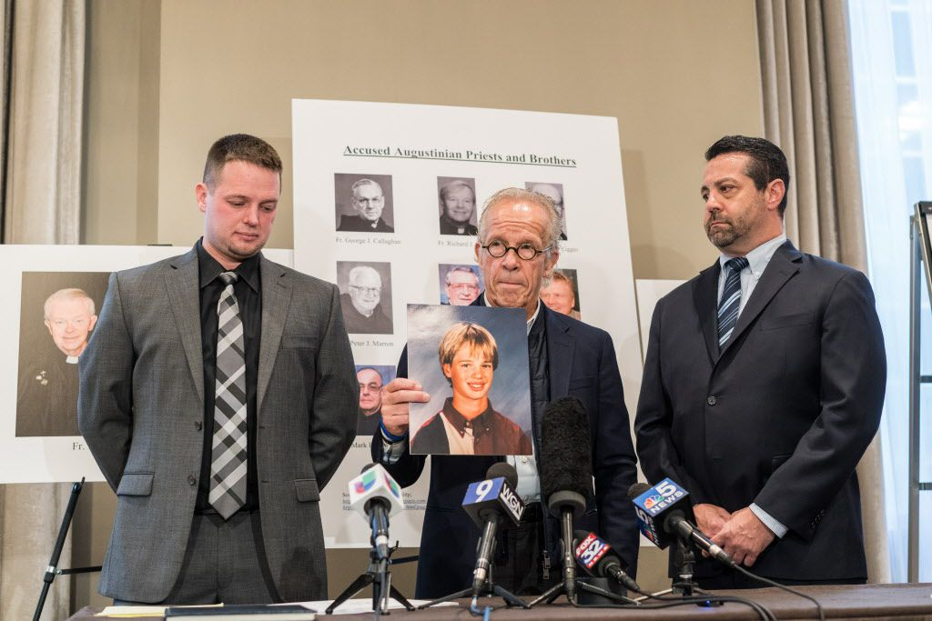 Attorney Jeff Anderson speaks at a press conference, with fellow attorney Marc Pearlman at right, and former Providence Catholic High School student Bob Krankvich at left, who is filing a lawsuit against the Augustinian Order alleging sexual abuse by Augu
