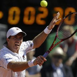 Argentina's Carlos Berlocq returns the ball to Czech Republic's Tomas Berdych during the Davis Cup semifinals tennis match in Buenos Aires, Argentina on Sunday, Sept. 16, 2012.