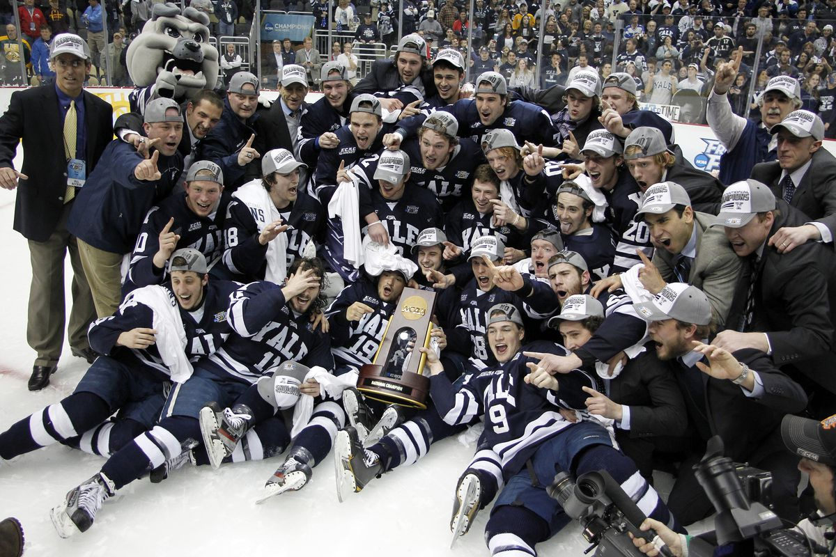Yale celebrates with the NCAA National Championship trophy.