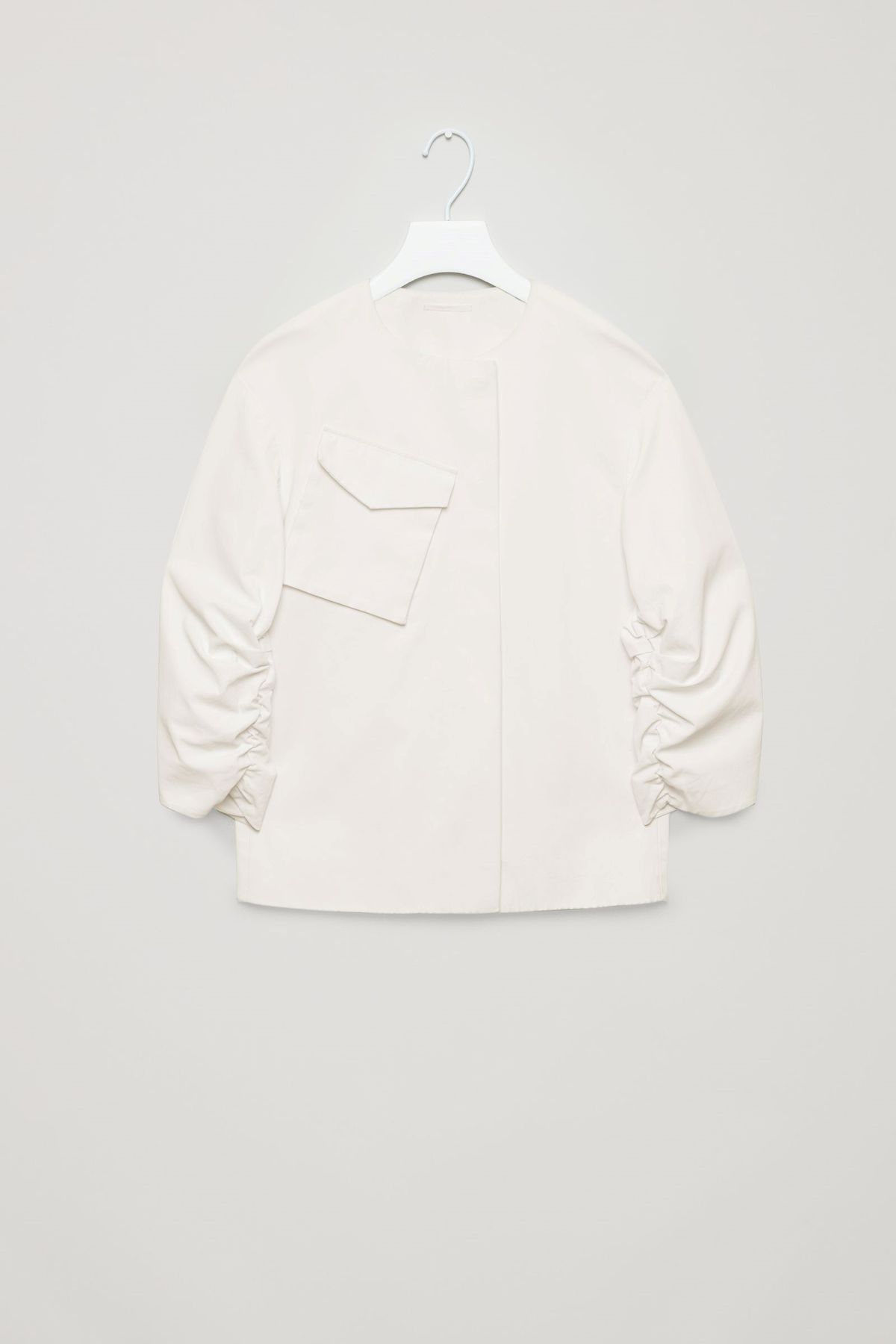 A jacket with ruched sleeves.