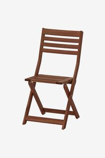 A wooden folding chair on white background