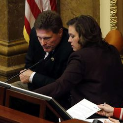 Rep. Jim Dunnigan, R-Taylorsville and House Speaker Becky Lockhart, R-Provo talks before he becomes Speaker pro tem at the Capitol in Salt Lake City, Thursday, March 13, 2014.