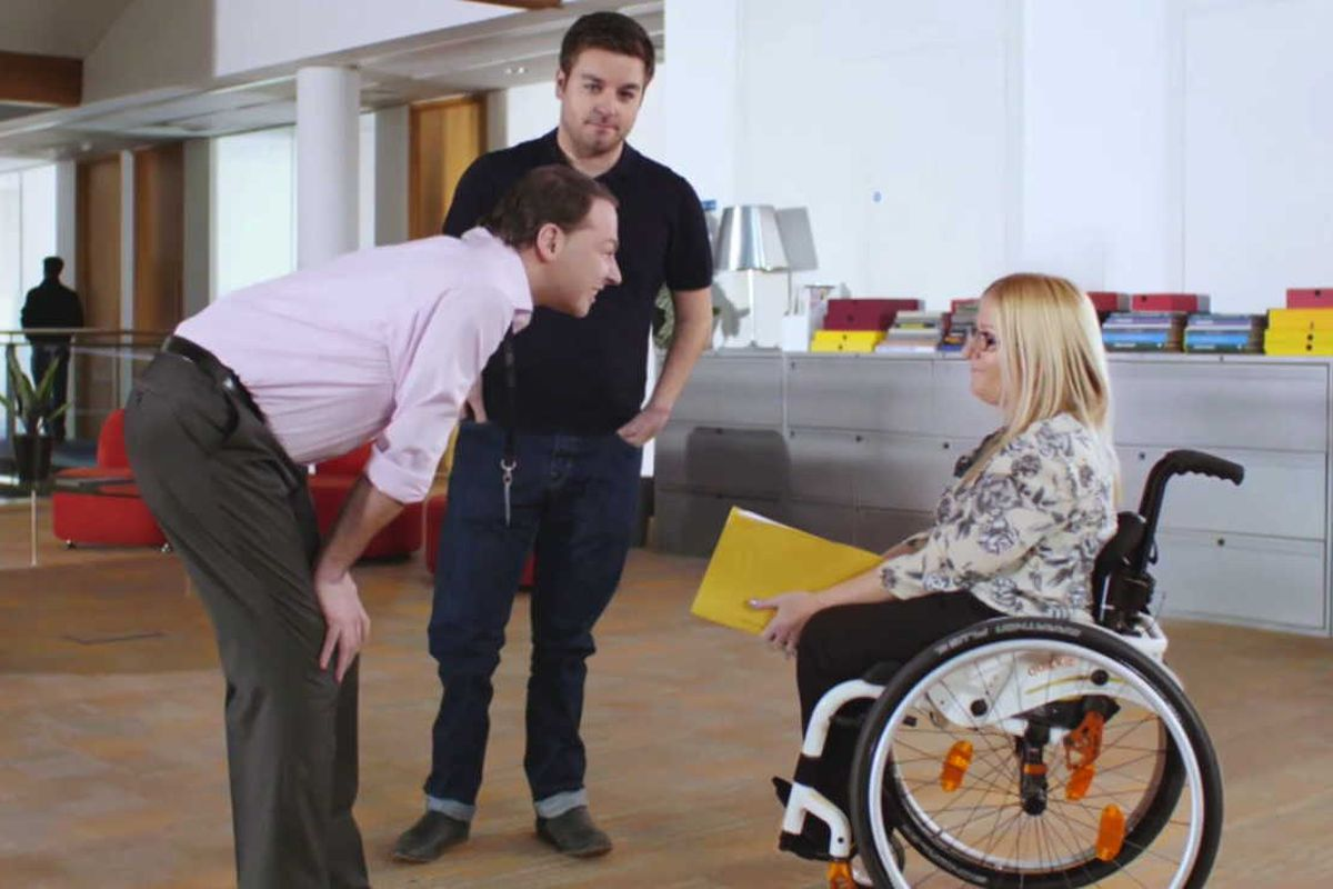 Alex Brooker provides color-commentary on this unfortunate fellow, who feels a need to bend down to talk to a wheelchair user.