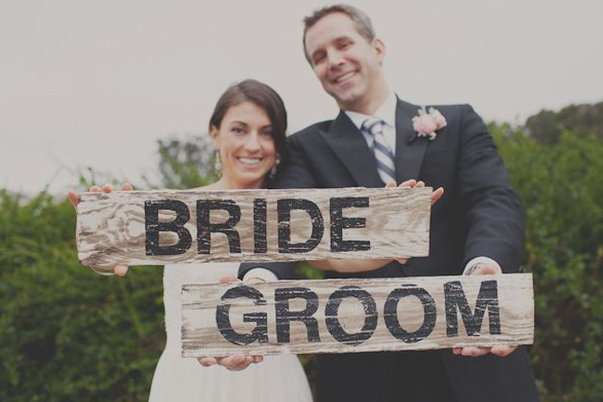 """Don't get upsold into paying more for rosewood bride and groom placards when reclaimed pine will do the trick. Photo by <a href=""""http://stonecrandall.com/"""">Stone Crandall Photography</a>"""