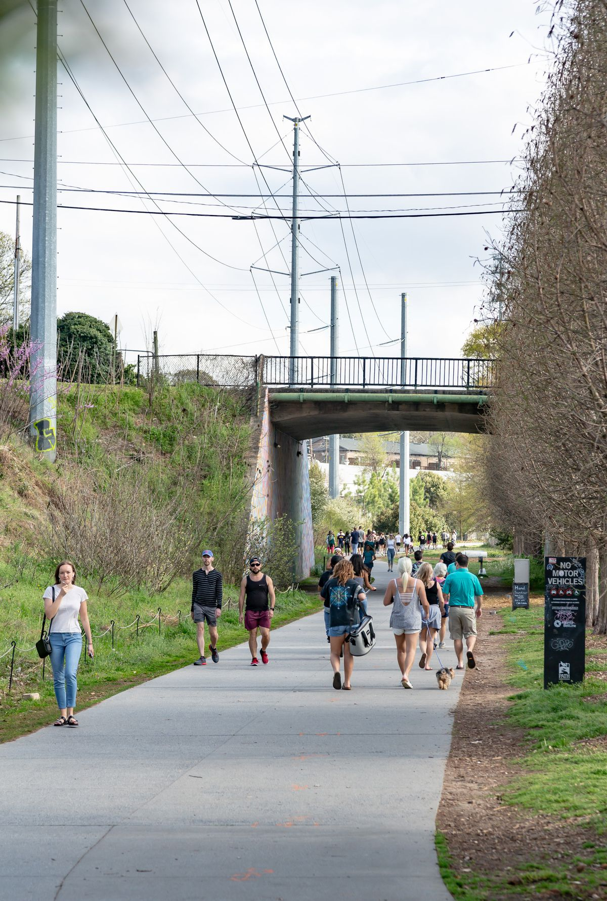 People walking the beginning at of the Eastside Beltline near the trail head at Monroe Drive march 21 amid COVID-19