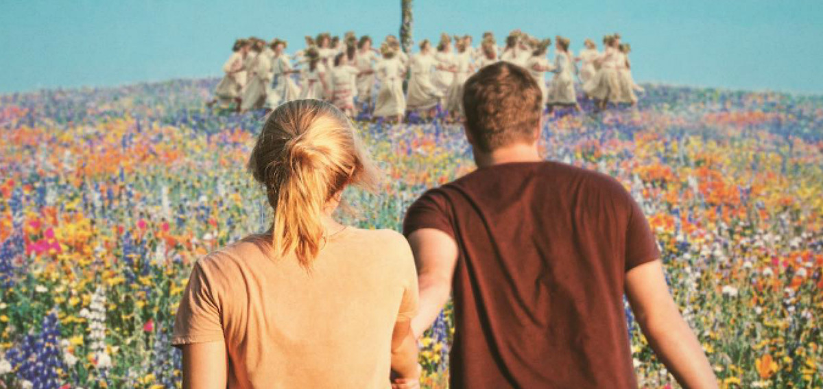 the leads of midsommar come upon a prismatic field of flowers and a group dancing around a maypole