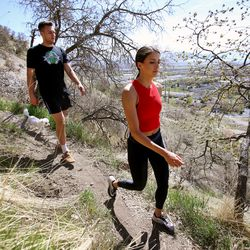 Kyle Collinsworth and his wife, Shea Collinsworth, go for a walk with their dog, Coco, on the mountain near their home in Provo on Wednesday, April 22, 2020.