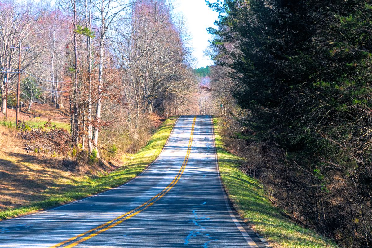 Rural road during the Winter season. Beauty in nature seen...