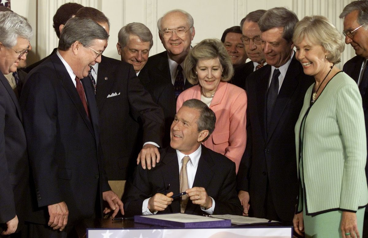 George W. Bush signs his 2001 round of tax cuts