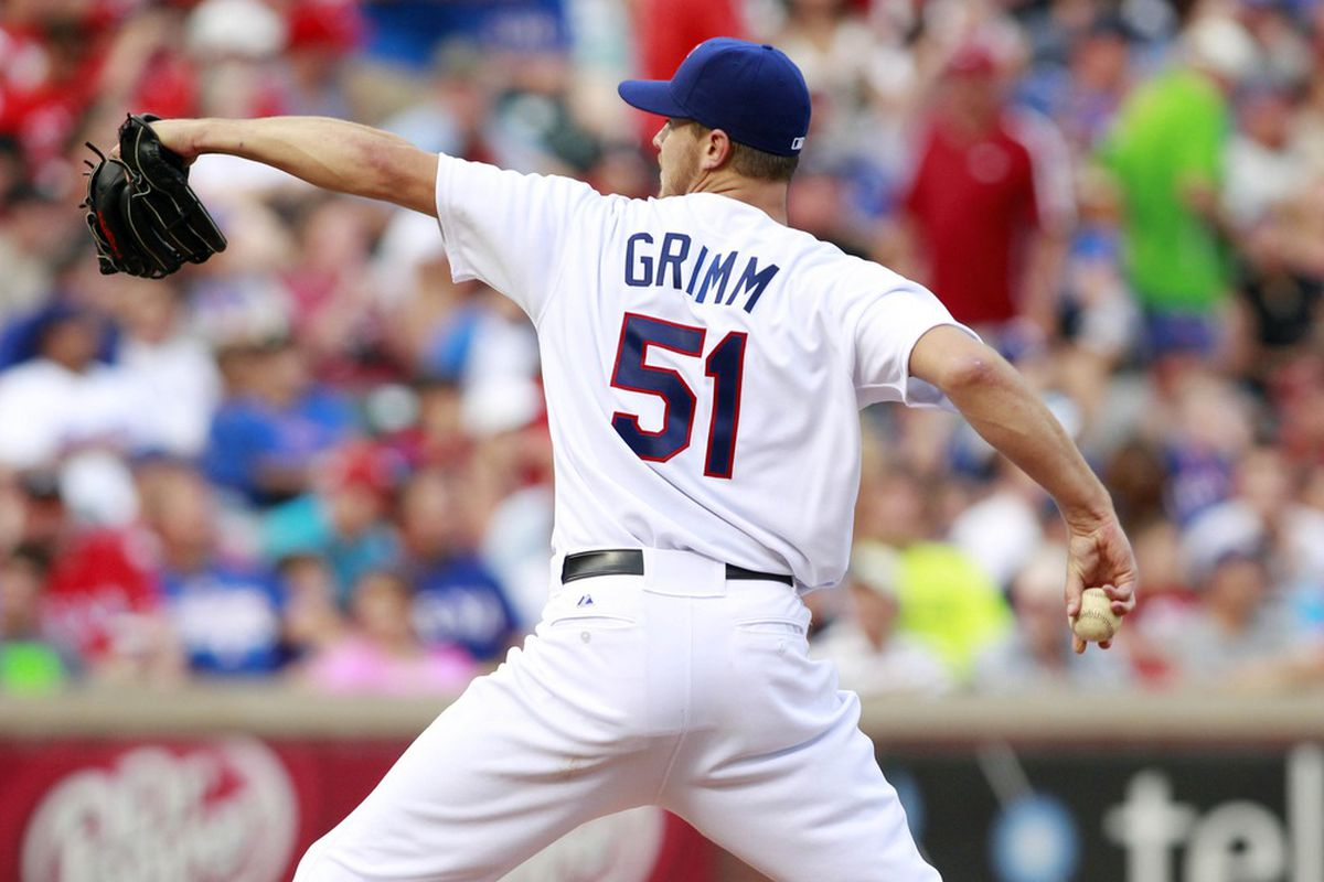 Jun 16, 2012; Arlington, TX, USA; Texas Rangers starting pitcher Justin Grimm (51) throws a pitch during the fifth inning of the game against the Houston Astros at Rangers Ballpark. Mandatory Credit: Tim Heitman-US PRESSWIRE