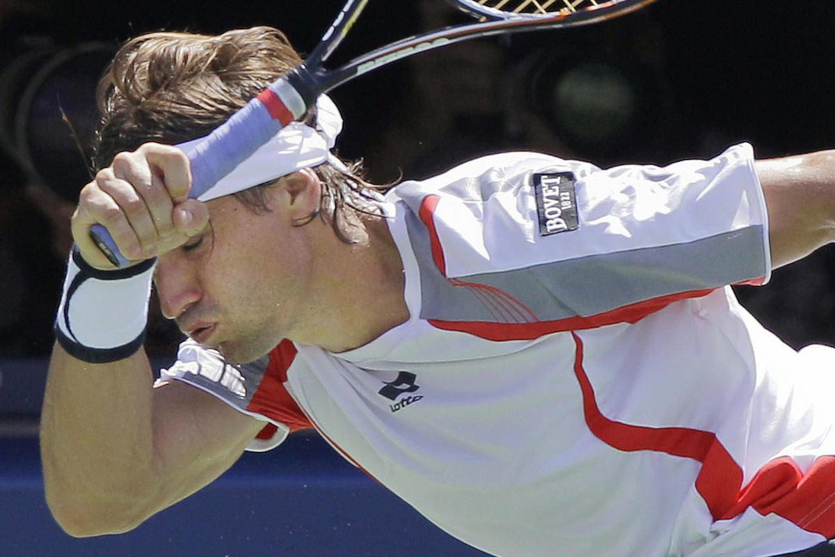 Spain's David Ferrer returns a shot to Serbia's Novak Djokovic during a semifinal match at the 2012 US Open tennis tournament, Sunday, Sept. 9, 2012, in New York. Ferrer lost the match.