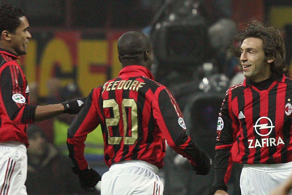 AC Milan's midfielder Andrea Pirlo (R) i