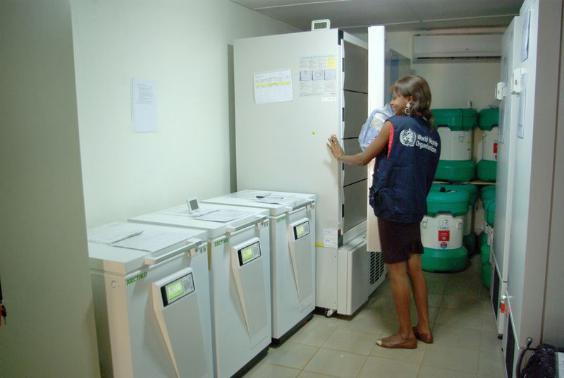 Sita Tozno, a specialist in cold storage from the World Health Organisation (WHO)makes sure that the temperature of the ebola vaccine in special containers does not rise above minus 80 degrees centigrade, in Conakry, Guinea, 10 November 2015.