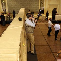 A mechitzah, or dividing wall, separates the men and women during a traditional Chabad Lubavitch Jewish wedding dinner at the Grand America Hotel in Salt Lake City on Monday, Sept. 12, 2016.