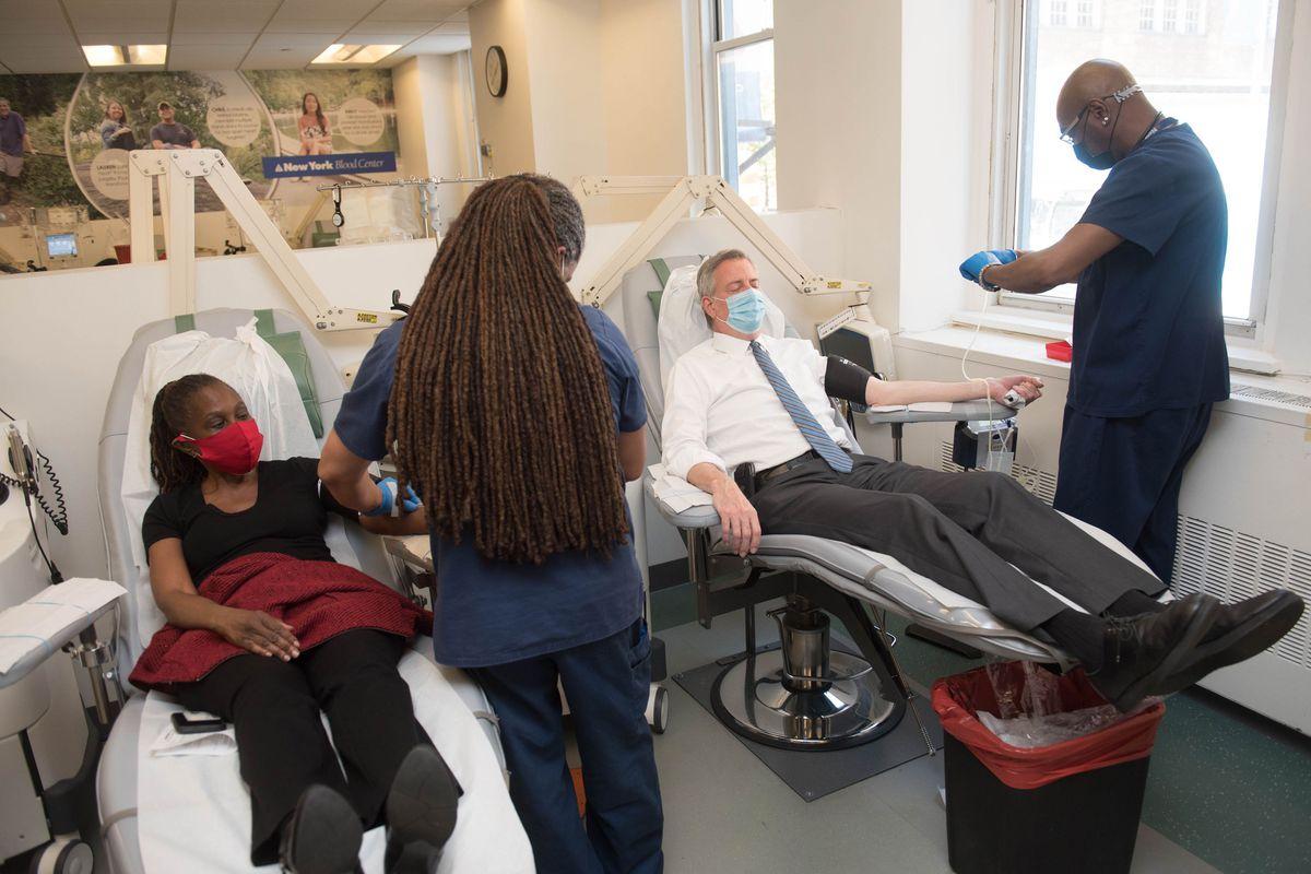 Mayor Bill de Blasio and First Lady Chirlane McCray donate blood during the coronavirus at the New York Blood Center in Manhattan.