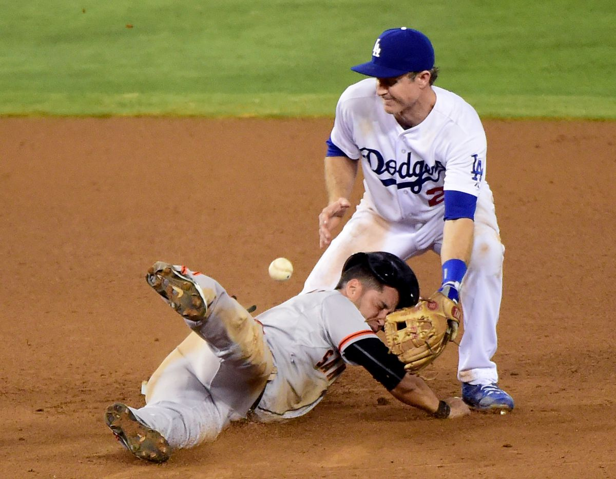 Chase Utley sticking his knee into Gregor Blanco's head