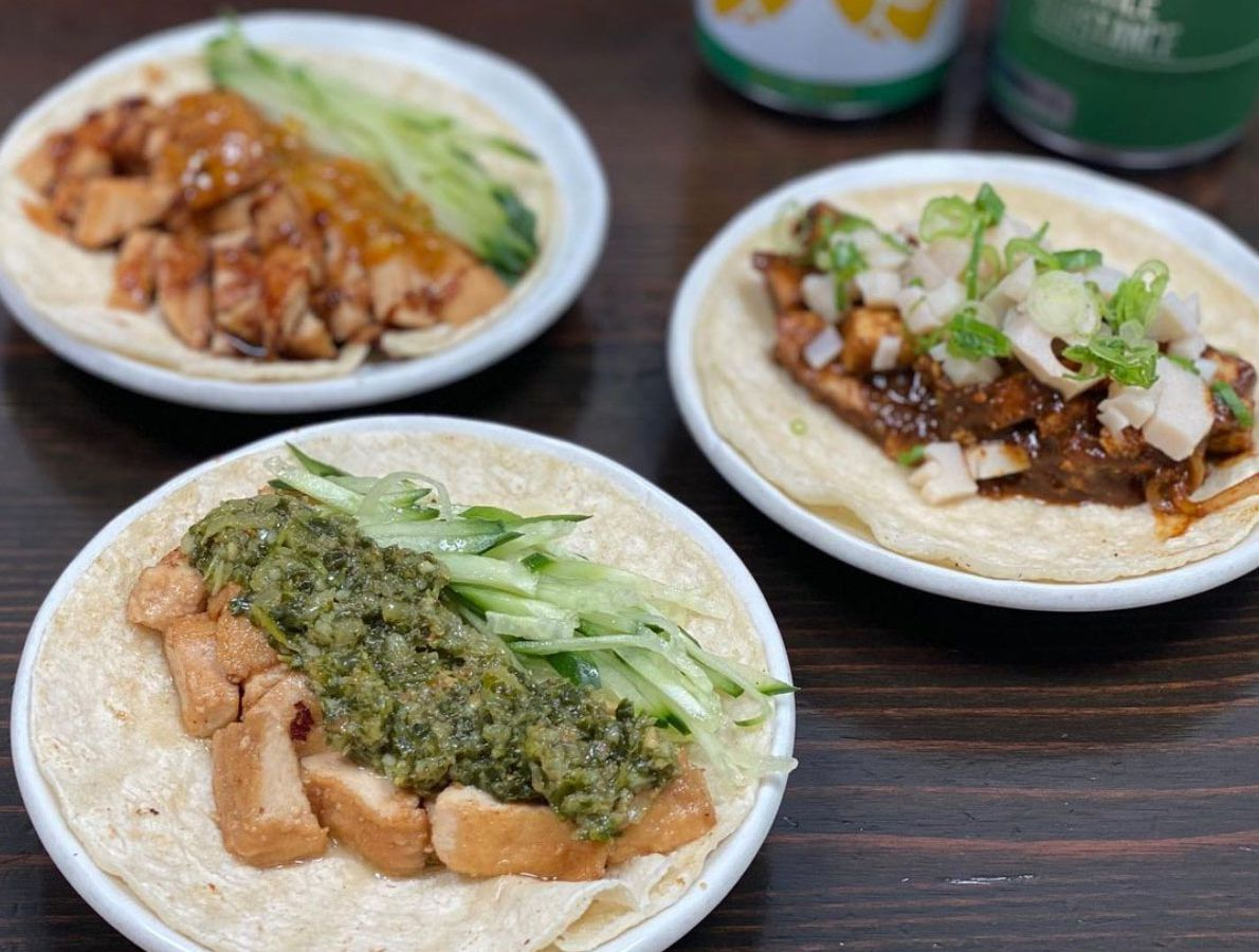 A picture of three vegan tacos with tofu, black bean sauce, and chimichurri style sauce at Kayo's Ramen Bar