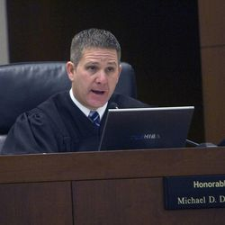 Judge Michael DiReda talks with lawyers on Jan. 18, 2011, during the innocence trial for Debra Brown trial. A judge ruled Monday that Brown, the first Utah inmate to try a new state law that allows for non DNA innocence claims, is innocent of the crime.