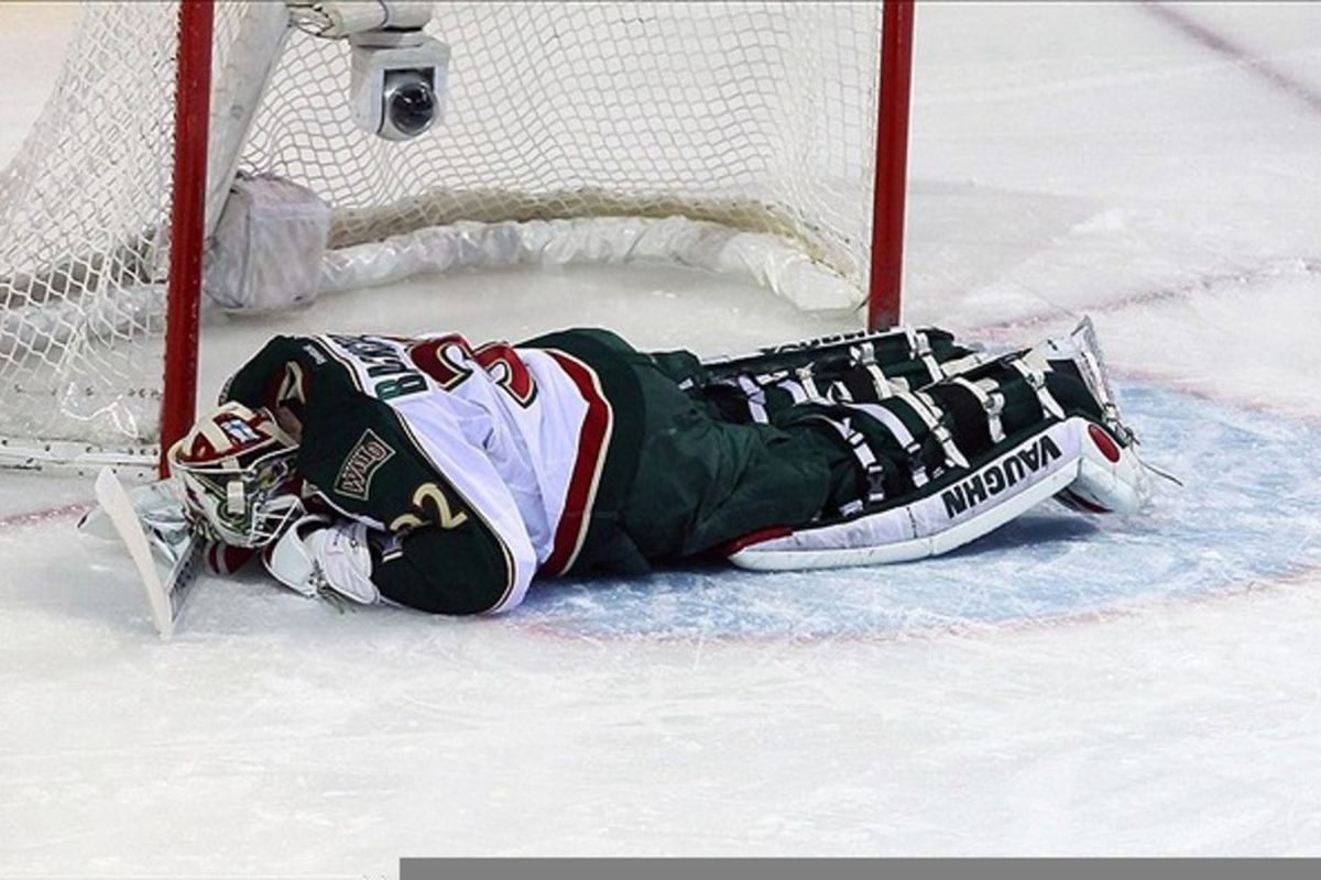 Mar 01, 2012; Montreal, QC, CAN; Minnesota Wild goalie Niklas Backstrom (32) lays on ice during the first period against Montreal Canadiens at the Bell Center. Mandatory Credit: Jean-Yves Ahern-US PRESSWIRE