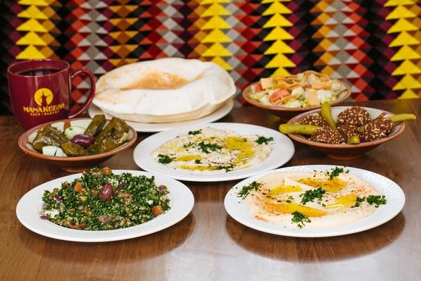 array of plates with middle eastern food