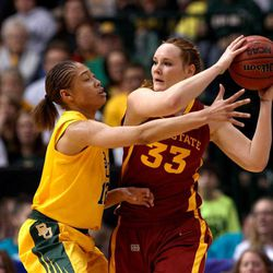 Baylor guard Alexis Prince (12) defends as Iowa State forward Chelsea Poppens (33) handles the ball during their NCAA college basketball championship game in the Big 12 Conference tournament, Monday, March 11, 2013, in Dallas. Baylor won 75-47.