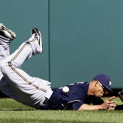 Milwaukee Brewers center fielder Carlos Gomez misses a ball hit by Washington Nationals' Jayson Werth, who had a two RBI double on the play, during the fourth inning of a baseball game, Monday, Sept. 24, 2012, in Washington. The Nationals won 12-2.
