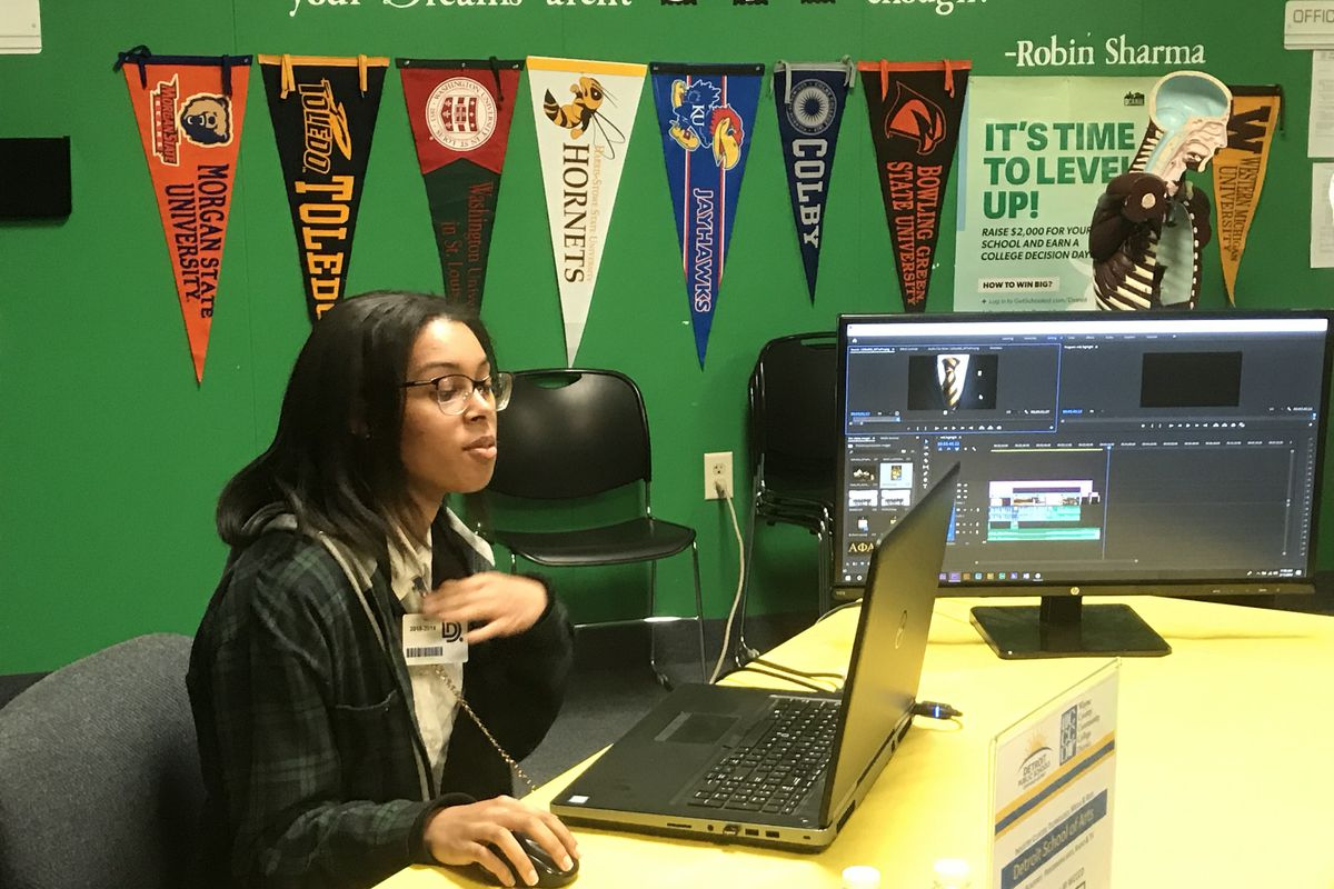 A student from Detroit School of Arts demonstrates using film editing software during a press conference about the Detroit district's efforts to increase career pathways and college dual enrollment courses.