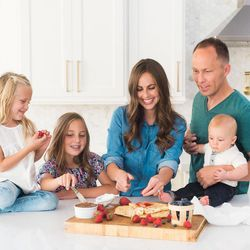 """Cade and Carrian Cheney, shown here with their family, are the authors of """"Our Sweet Basil Kitchen.""""  According to Cade Cheney, the mission of """"Our Sweet Basil Kitchen"""" is to get families back into the kitchen and spending time together. """"It's not about the food. Food is just the means to that end,"""" he said."""