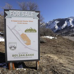 A real estate sign advertises lots for sale near the mouth of Little Cottonwood Canyon in Cottonwood Heights on Friday, Feb. 21, 2020. Utah Open Lands is trying to raise funds to preserve a 26-acre parcel of land, including a section of the Bonneville Shoreline Trail, and prevent development.