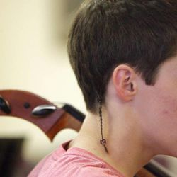 Gifted Music School orchestra student Chase Ferry practices in Salt Lake City on April 13.