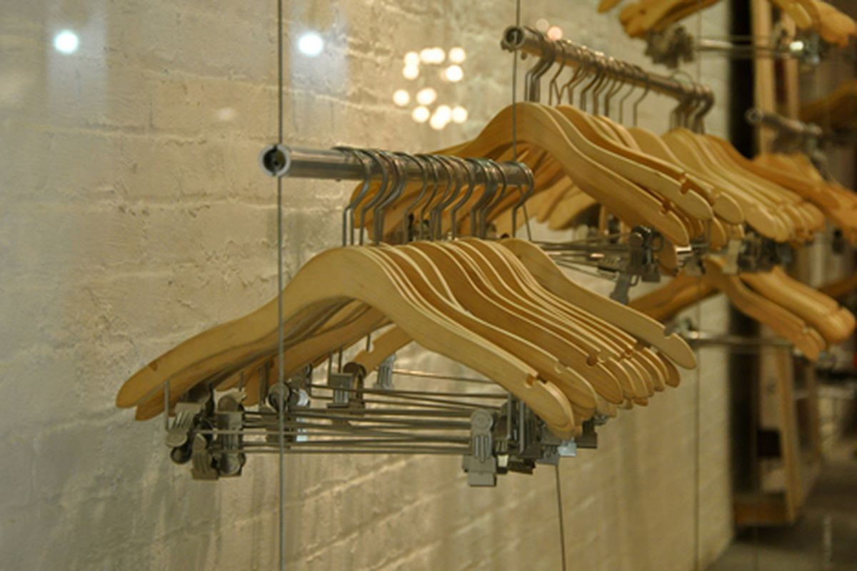 """A flock of hangers in a Mott Street storefront via <a href=""""http://www.flickr.com/photos/essgee/4319917223/in/pool-rackedny"""">EssG</a>/Racked Flickr Pool"""